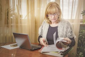 Menopause at work: menopausal woman working from home