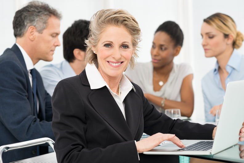Portrait Of Smiling Mature Businesswoman Looking At Camera